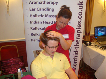 Liz giving an Indian Head Massage at the BCTC Wellbeing event